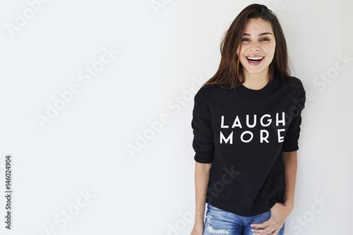 Fotografiet  Laughing brunette in slogan sweatshirt, portrait