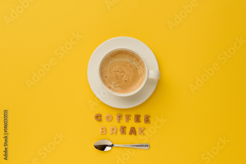 Fotografie, Obraz  top view of cup of espresso coffee, spoon and coffee break lettering