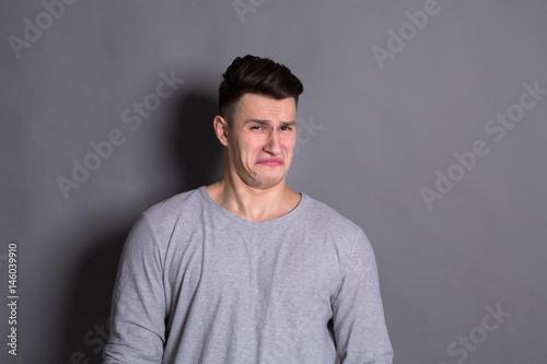 Fotografie, Tablou  Negative human emotion, man expressing disgust