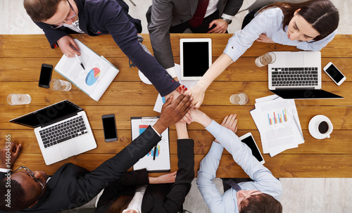 Photo  Teamwork and teambuilding concept in office, people connect hand