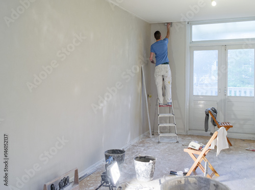 a plasterer working in a house