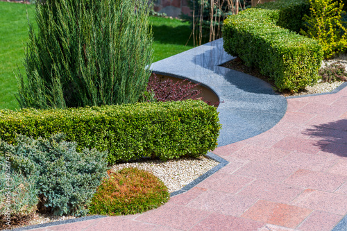 Fotobehang Lichtroze Plants and bushes in landscape design