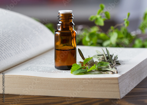 Photo  Essential oil and aromatherapy book