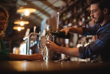 Male Bar Tender Pouring Wine I...