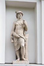 Mercury - God Is The Patron Of Trade. Statue Of Pudozh Stone In The Niche Of The Kitchen Corps Of The Elagin Island Palace And Park Complex In St. Petersburg