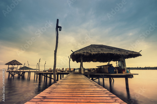 abstract retro ocean dock wood bridge in the sea vintage filter - can use to display or montage on product