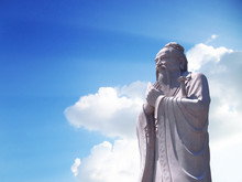 Confucius Statue With Sky Back...