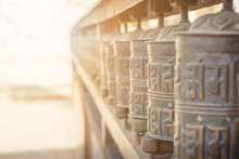 Background Of Prayer Wheel In Buddhist Temple In Tibet With Lens Flare
