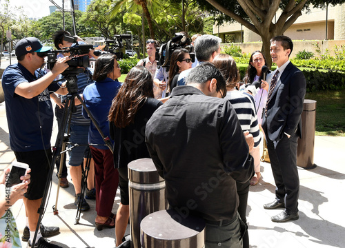 Hawaii Attorney General Douglas Chin talks to the media at