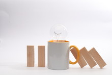A Cup Of Tea Or Coffee Stop The Domino Principle. Business Concept. On A White Wooden Background. Horizontally.