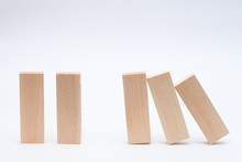 The Domino Principle Is Stopped. Successful Business. Solution. Business Concept. On A White Background. Horizontally.