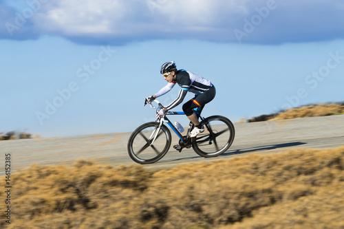 Cyclist man riding mountain bike on a mountain road - Buy
