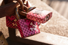 Pink Love Locks With Skulls And Crossbones