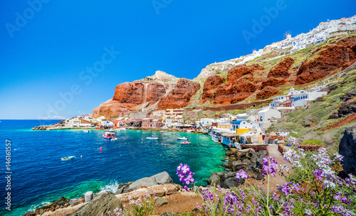 The old harbor of Ammoudi under the famous village of Ia at Santorini, Greece Canvas Print