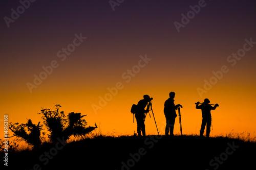 Foto op Aluminium Jacht Silhouette of aphotographers top of mountain on sunset.