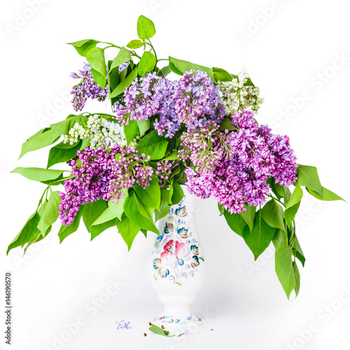 Fotobehang Lilac A fragment of a lilac bouquet in a porcelain vase