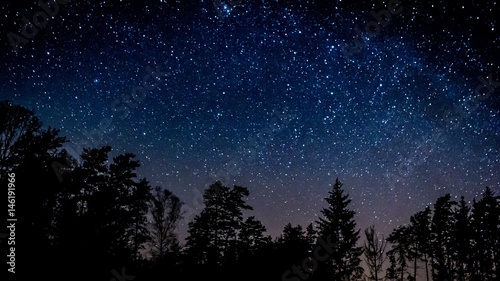 Fotobehang Nacht Night sky over rural landscape