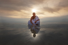 Monk Novice Looks Into His Reflection