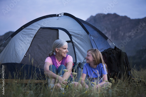 Tuinposter Kamperen Caucasian grandmother and granddaughter camping on mountain