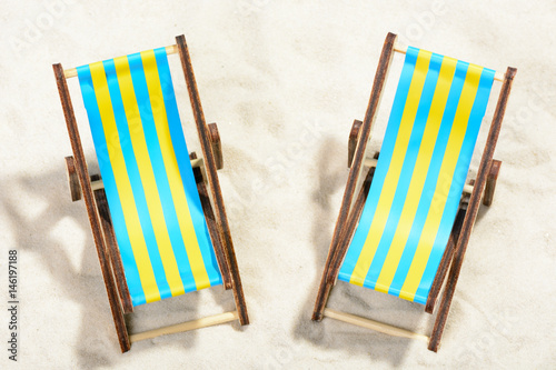 Canvas-taulu Two sunbeds on the beach: top view