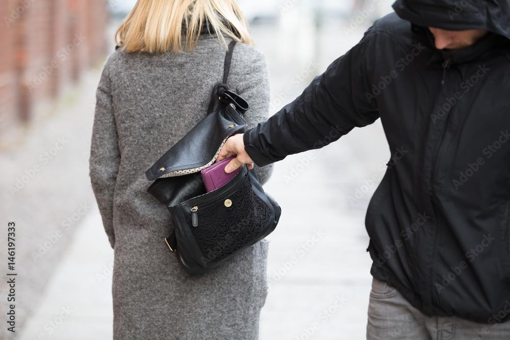 Fototapeta Person Stealing Purse From Handbag