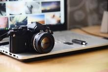 Digital Studio Photography Workstation. Retro Film DSLR Camera, Laptop Computer Screen And Flash Drive Memory Card