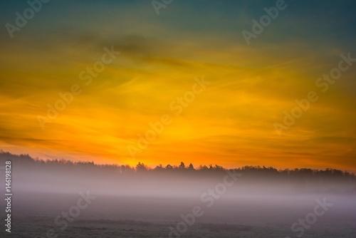 Poster Zonsondergang Beautiful foggy morning on polish meadow