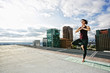 Caucasian woman doing yoga urban rooftop