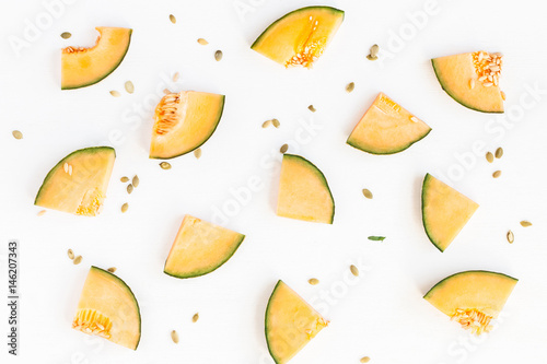 Fotografia Sliced melon on white background. Flat lay, top view