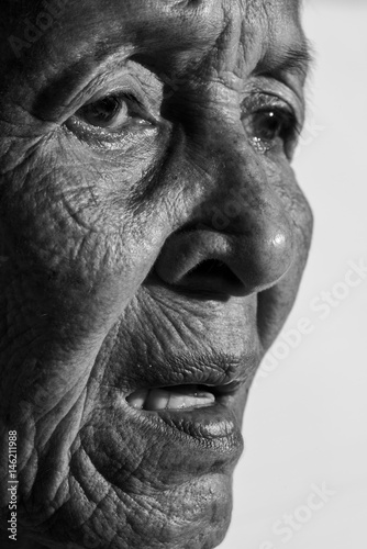 Lonely senior woman  portrait sad depressed,emotion, feelings, thoughtful, senior, old woman,wait, gloomy, worried, covering her face, Human face expressions, isolated black background