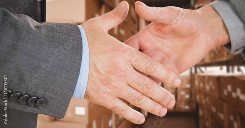 Staande foto Manicure Business executives shaking hands in warehouse