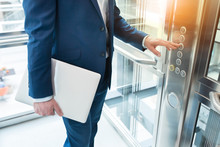 Men Finger Presses The Elevator Button