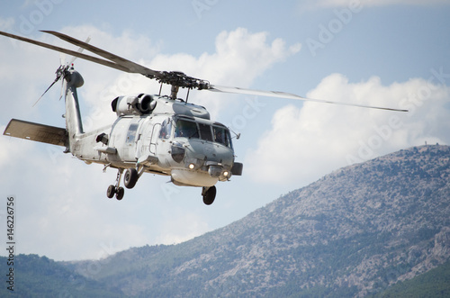 Tuinposter Helicopter Black hawk helicopter rescue team.Close up,nose down low flight maneuvering