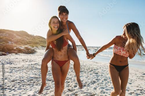 Beautiful female friends having fun at the beach