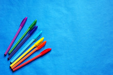Colored Pens On A Blue Background