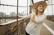 Portrait of smiling Caucasian woman on bridge