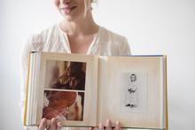 Caucasian Woman Showing Photo ...