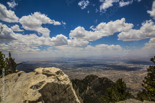 looking down on a big city from a mountain top Canvas Print