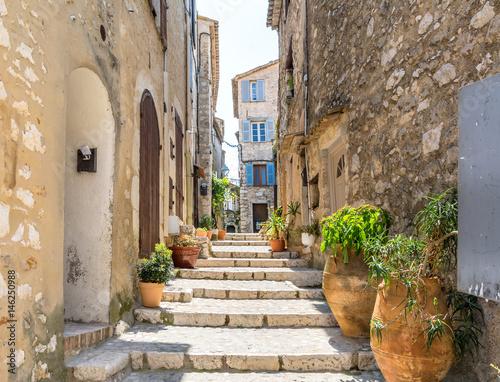typical narrow street in Saint Paul de Vence, France - 146250988