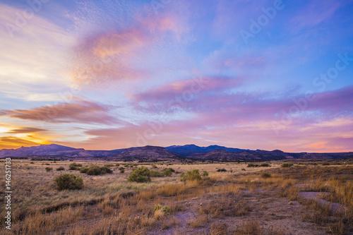 Canvas sunset over desert mountains