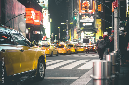 Photo sur Toile New York TAXI Times Square by Night - New York