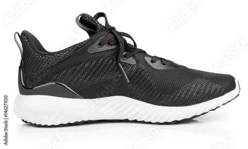 Fotografia  Single new unbranded black sport running shoe, sneakers or trainers isolated on