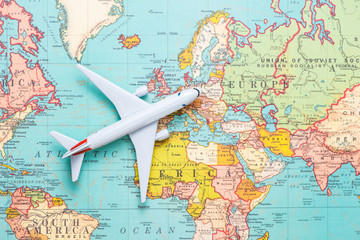 Fototapeta na wymiar Travel. Trip. Vacation - Top view airplane with touristic map