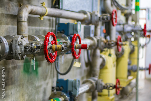 Photo  Red hand wheel of valve in the power plant and petrochemical plant
