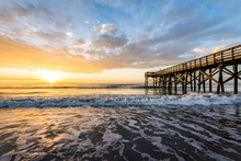 Isle Of Palms Pier At Sunrise In Charleston, South Carolina