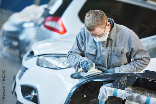 auto repairman grinding autobody bonnet Wallpaper Mural