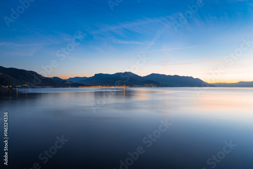 Fotografie, Obraz  Lake Maggiore, Maccagno, Italy. Panorama towards Luino, at sunset