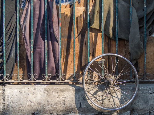 Abandoned bicycle wheel on the fence in the Intramuros,Manila,Philippines