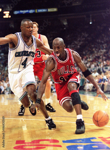 a0393b6ac5 Chicago Bulls guard Michael Jordan (R) goes around Charlotte Hornets Darrin  Hancock during first