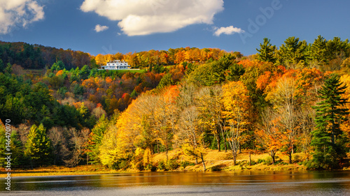 Stickers pour portes Orange eclat Autumn view of Moses Cone Manor from Bass Lake near the Blue Ridge Parkway